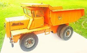 Vintage Buddy L Hydraulic Mack M series large Dump Truck, orange in color