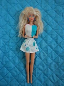 BARBIE WITH  BLUE HOOP EARRINGS & MATCHING RING UNITED COLORS BENETTON?