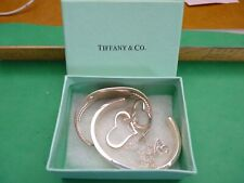 TIFFANY AND CO BOX WITH BRACLET AND HEARTS ON SILVER CHAIN.