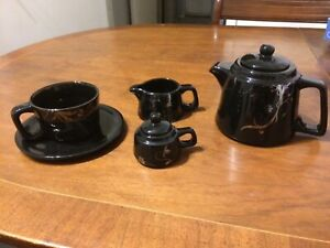 Tea/coffee set for 1. Black with decoration. 5 Pieces.