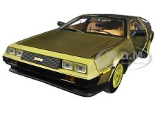1981 DE LOREAN DMC 12 COUPE GOLD EDITION 1:18 DIECAST MODEL CAR BY SUNSTAR 2702