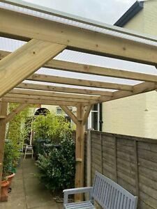 Wooden pergola with polycarbonate roof