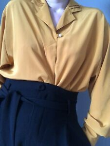 Vintage blouse, 1980s or 90s but has 1940's style, excellent condition.