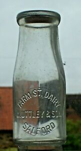 Half-pint wide-necked milk bottle from UTTLEY, SALFORD.