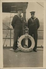 WW1 sailor Royal Navy HMS Defiance standing by a life belt for HMS Cleopatra