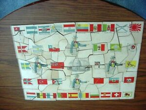 BC31 Vintage 1915 Milton Bradley US Map puzzle showing flags & Uncle Sam on Rev