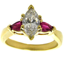 Three Stone Marquise Diamond Engagement Ring with Ruby Accents