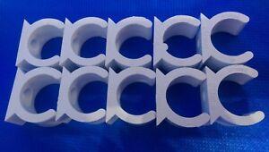 20MM WHITE HIGH IMPACT PVC SPRING CLIP SADDLE PACKS OF 10