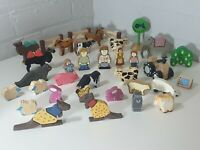 Bundle of wooden animals and people with farm and safari tractor etc