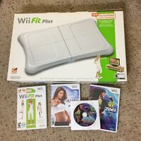 Wii Workout Bundle - Nintendo Wii Fit Plus with Balance Board and 4 Games