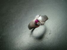 Beautiful Sterling Silver Art Deco style buckle ring with diamonds and ruby.