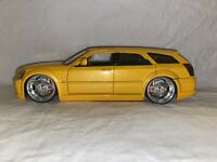 DUB CITY 2006 Dodge Magnum R/T Yellow 1/24 Diecast Jada Toys No. 90296