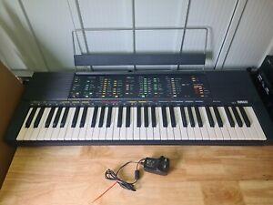 Vintage Yamaha Keyboard PSR-70 with music stand