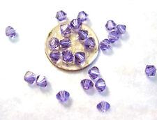 24 Swarovski Crystal Beads Xilion # 5328 Tanzanite 4mm