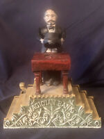 Vintage Cast Iron Mechanical Magician Penny Bank Reproduction
