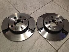 VAUXHALL CORSA C H/BACKS 00-06 TWO FRONT SOLID BRAKE DISCS  BRAKE PADS SET NEW