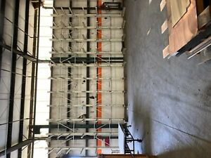 Cantilever Steel Racking. 11 total- 20' Tall with 6 arms x 4' long