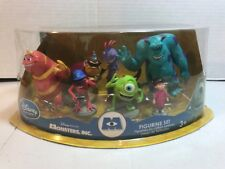 NIP DISNEY STORE MONSTERS INC FIGURINE SET  W   7 FIGURES  BOO SULLY MIKE  MORE