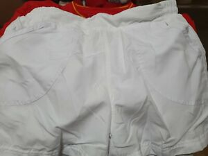 USED LADIES LA GEAR LINED WHITE SHORTS SIZE 10 FRONT AND BACK POCKETS