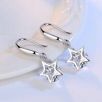 Orecchini pendenti in argento con stella e cristallo
