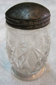 An old glass salt container for dinning table use