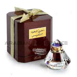 Dhan al Oudh al Nafees 6ml by Rasasi •Luxury •Oil/Woody/Rose/Amber 100% Original