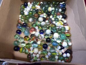 A COLECTION OF 300 + GLASS MARBLES.