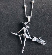 Sexy witch on the broom with her cat, sterling silver pendant