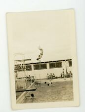 Man caught in midair dive into pool - stop action Vintage snapshot found photo