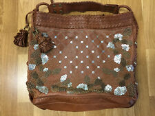 ISABELLE FIORE HEAVILY DETAILED BROWN LEATHER BAG
