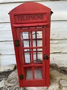 Red telephone box lantern made out of Metal