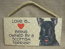"""Love Is Being Owned By A Scottish Terrier"" Wooden Plaque"