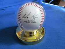NOLAN RYAN #34 FACSIMILE SIGNED BASEBALL AND BALL HOLDER.