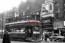PHOTO  1958 BRIGGATE LEEDS TRAM CAR 198 REVERSES ON THE CROSSOVER AT BRIGGATE IN