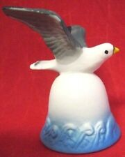 Flying Seagull Decorative Bell Over Water White Blue