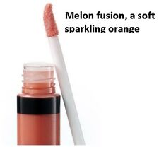 b834cc79cbf Laura Geller Color Drenched Lip Gloss in MELON INFUSION, a soft sparkling  orange