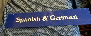 LARGE VTG SIGN SPANISH AND GERMAN BLUE WHITE 30X6 ADVERTISING BOOK STORE