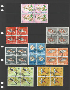 SINGAPORE STAMPS USED BLOCKS OF THE 1962 FISH, FLOWER& BIRD ISSUE. FINE CANCELS
