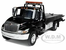 INTERNATIONAL DURASTAR 4400 FLAT BED TOW TRUCK BLACK 1/24 BY JADA 92351