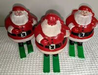 Vintage ROSBRO Christmas HARD PLASTIC SANTA On Skis Candy Container SET OF 3