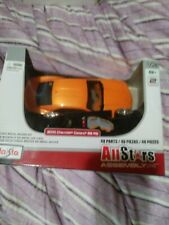 All Stars Assembly Line Model Kit.  maisto good condition yellow car