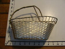 French woven silver (colored) metal basket bottle holder