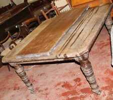 Solid Walnut Windout Table with Leaves Turned legs on castors attention needed