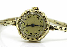 Runde Armbanduhren aus Massivgold mit arabischen Ziffern