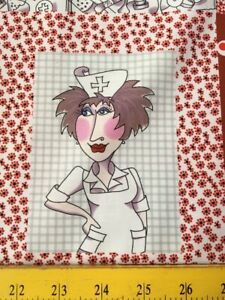 "Loralie Designs Fabric of Nurses 23"" Panel w Red Squares"