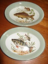TWO SMALL SERVING DISHES DEPICTING FISHES