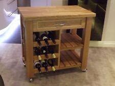 Solid oak kitchen island on wheels with bespoke wine rack
