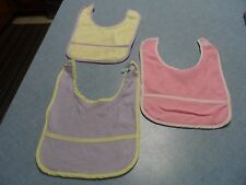 3 Cutie Pie baby bibs with a front pocket area