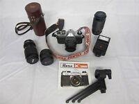 Pentax K1000 35mm SLR Camera with 50mm lens, 3 additional lenses, flash & bag
