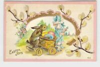ANTIQUE POSTCARD EASTER BUNNY RABBIT GIRL PULLING CARD EGGS EMBOSSED PUSSY WILLO